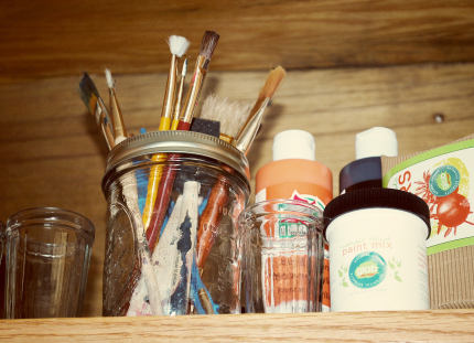 Paint Brushes and Paint in Jars
