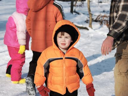 Little Boy Hiking in the Winter Woods