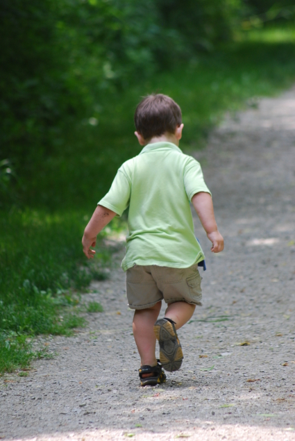 Child walking on the trail
