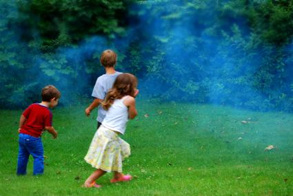 Kids running in the fog