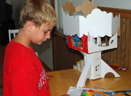 Playing with a Cardboard Tree House